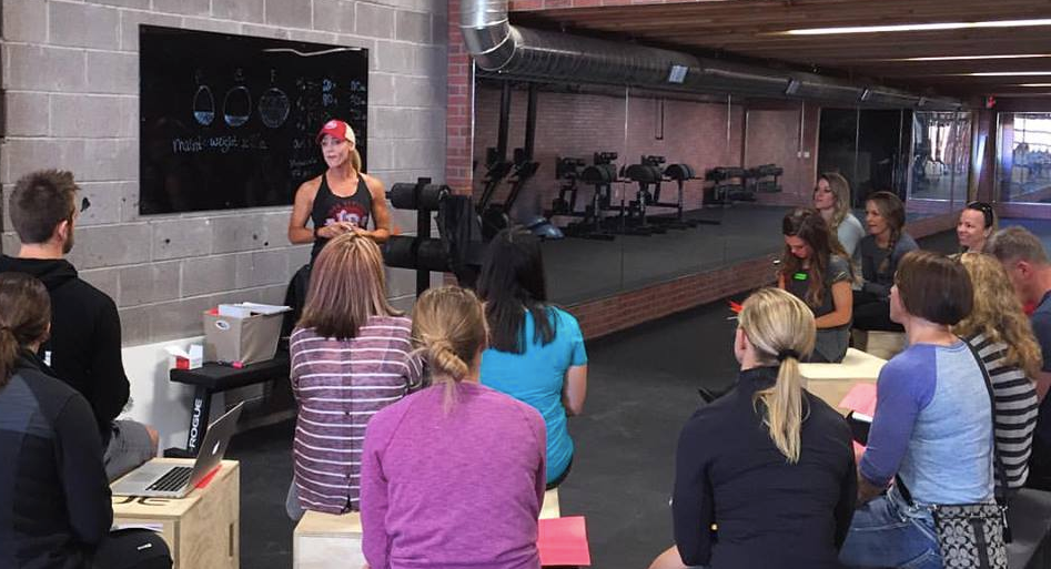 Iron Athlete Nutrition Coach Kelli Michelle Coaching a Cllinic