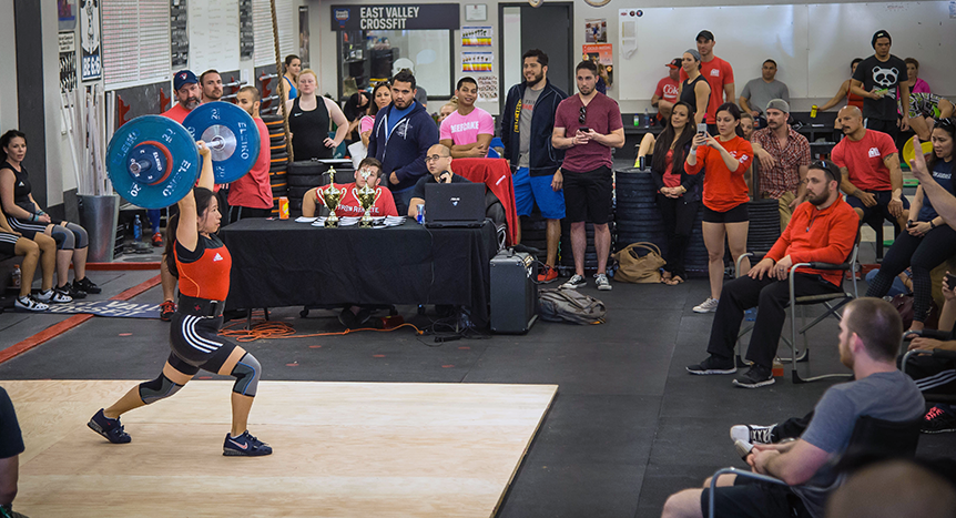 Iron Athlete Coach Becky Vasey lifting in a competition at East Valley CrossFit