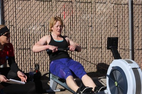 Iron Athlete Rowing Coach Kare Williams On Her Rower In A CrossFit Competition