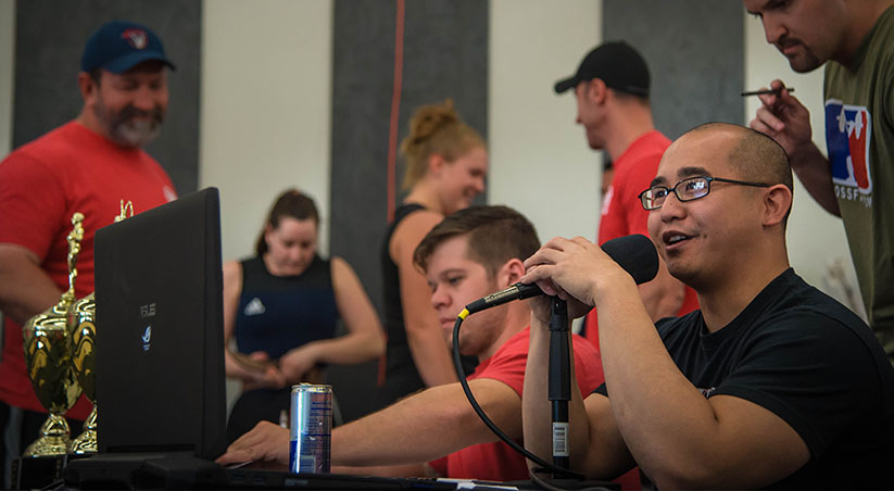 Jeremy Galo Speaking at a Weightlifting Competition