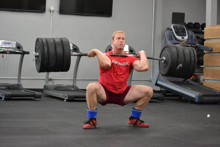 Iron Athlete Jason Lewis Weightlifting At A Clinic