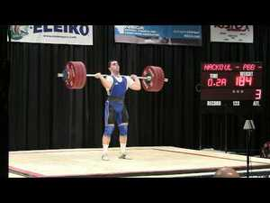 Iron Athlete And Weightlifter John McGovern Competing In A Weightlifting Competition