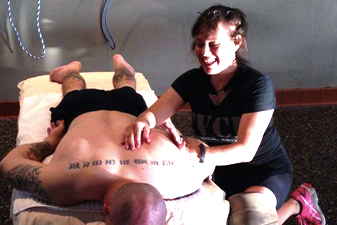 Iron Athlete Trainer Marie Finamore Massaging A CrossFit Athlete